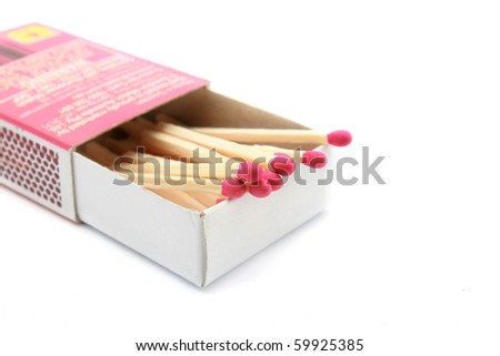 red matches in a white box isolated on a white background. - stock photo