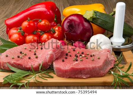 red meat with fresh vegetables - stock photo