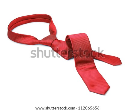 Red men's tie taken off for leisure time, white background isolated - stock photo