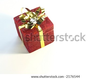 Red mesh Christmas gift box with shiny gold bow and ribbon on white background.