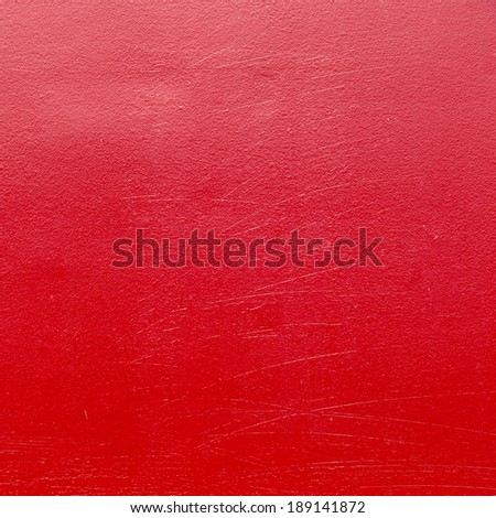 red metal background painted in red with scratches - stock photo