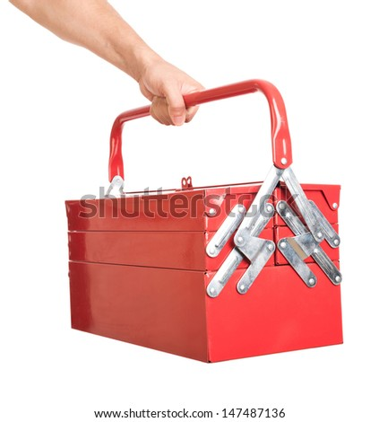 Red metal toolbox in a man's hand