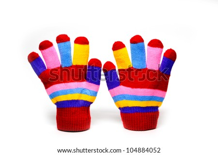red mittens with color stripes over white - stock photo