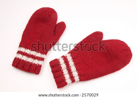 red mittens with white stripe on wrist over white - stock photo