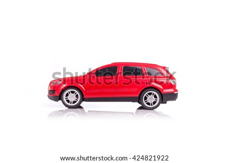 Red model car with reflection isolated on white background