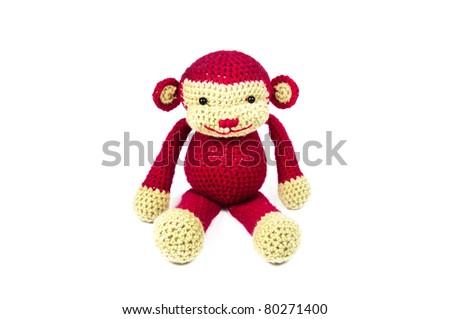 Red Monkey Knitting doll  - stock photo