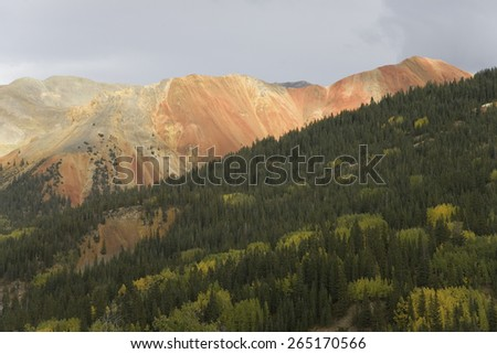 Red Mountain in autumn color off Route 550 south of Silverton Colorado - stock photo