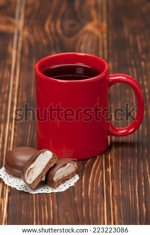 Red Mug Of Tea Or Coffee. Chocolate Marshmallows. Wooden Background.