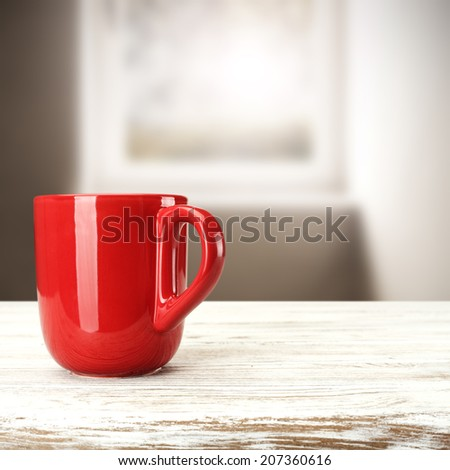 red mug on white desk  - stock photo
