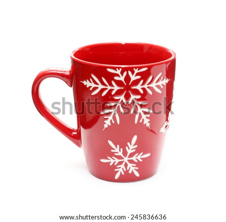 Red mug with snowflakes isolated on white - stock photo