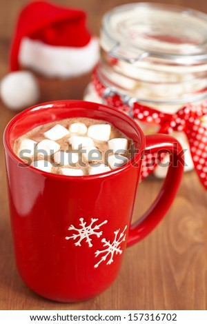 Red mugs with hot chocolate and marshmallows - stock photo