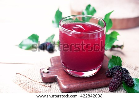 red mulberry juice on the table - stock photo