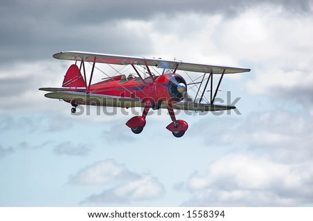 Red 1943 N2S-3 Stearman Navy trainer - stock photo