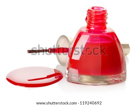 Red nail polish and brush isolated on a white background
