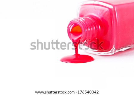 red nail polish spilled on white background  - stock photo