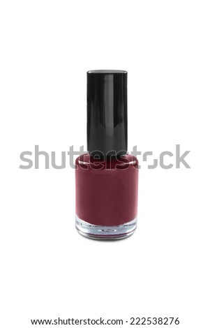 Red nail polish vial isolated over white