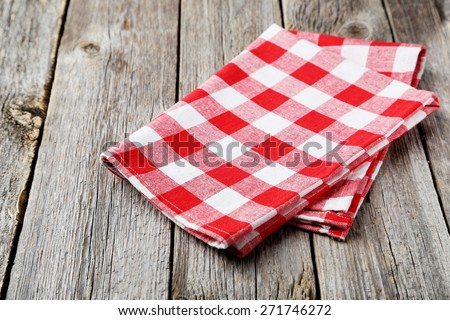 Red napkin on grey wooden background - stock photo