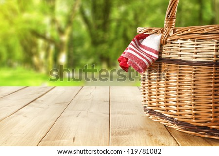 red napkin picnic basket and table place  - stock photo