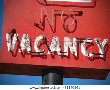 red neon no vacancy motel sign - stock photo