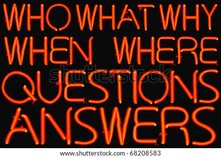 Red neon sign of common questions and answers.