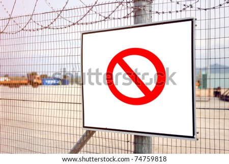 Red no entry sign on industrial fence - stock photo