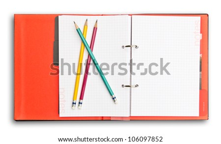 red notebook and pencil isolated with clipping path - stock photo