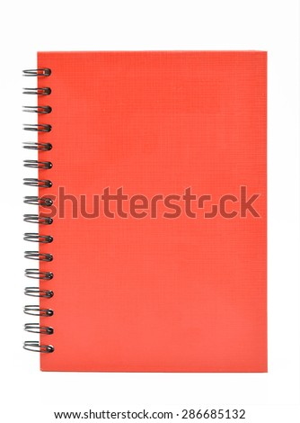 red notebook on white