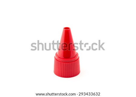 Red nozzle for decorate pastry. - stock photo