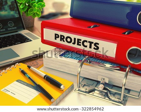 Red Office Folder with Inscription Projects on Office Desktop with Office Supplies and Modern Laptop. Business Concept on Blurred Background. Toned Image. - stock photo