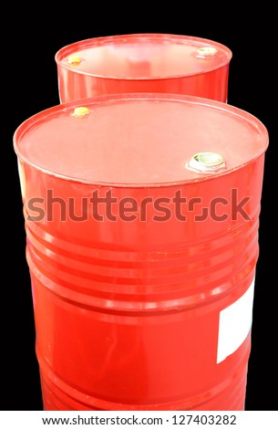 Red oil barrels isolated on black background. - stock photo