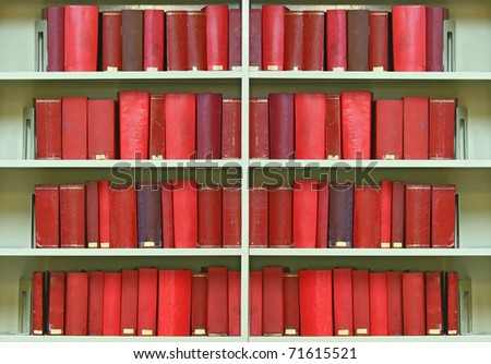 red old hardcover books on shelf - stock photo