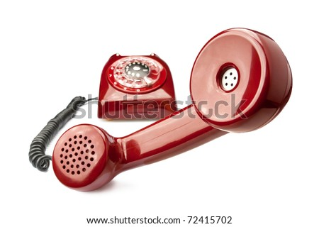 Red old phone isolated on white background - stock photo