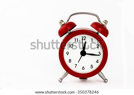 Red old style alarm clock isolated on white background