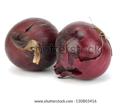 Red onion bulbs on white background
