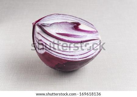 Red Onion split in half - stock photo