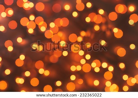 Red orange Lights on dark red background. abstract silver background with texture,  holiday bokeh. Abstract Christmas background - stock photo
