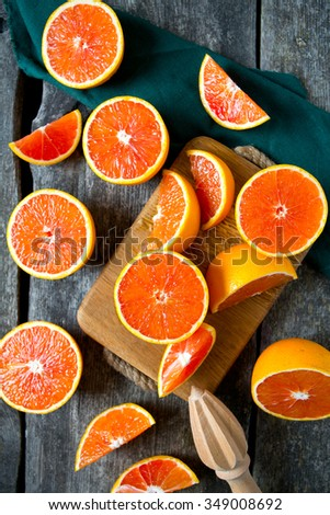 red oranges on wooden surface - stock photo