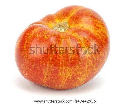 Red organic zebra tomatoes on a white background - stock photo
