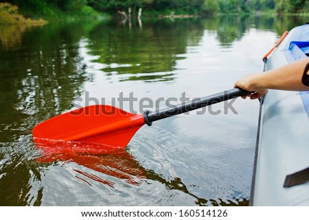 Red paddles for white water rafting and kayaking - stock photo