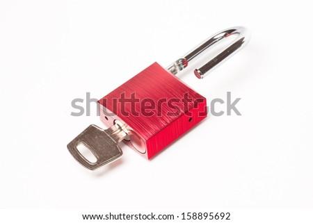 Red padlock closeup on white background - stock photo