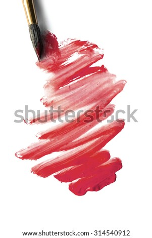 Red paint and a brush isolated over white
