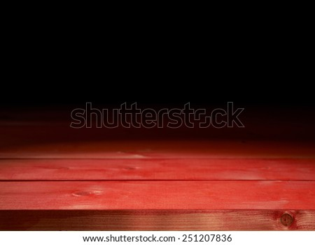 Red paint coated wooden boards copyspace background composition with the low key lighting - stock photo