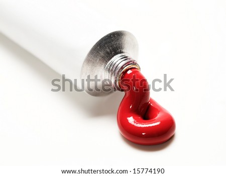 red paint coming out of the tube - stock photo