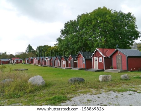 Red painted fisherman houses in the fishermen harbour of Slite on the island Gotland in Sweden