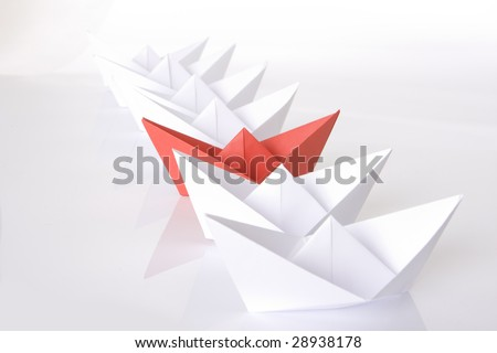 Red paper boat in the line - stock photo