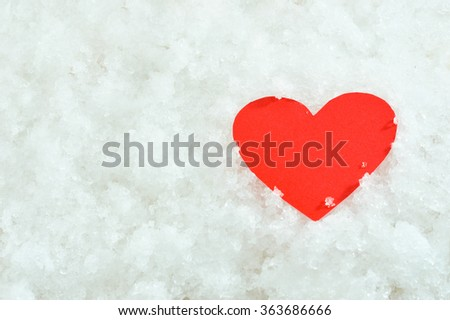 Red paper heart on snow background , valentine day concept