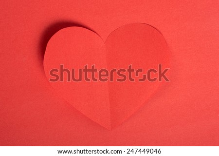 red paper hearts on a red background