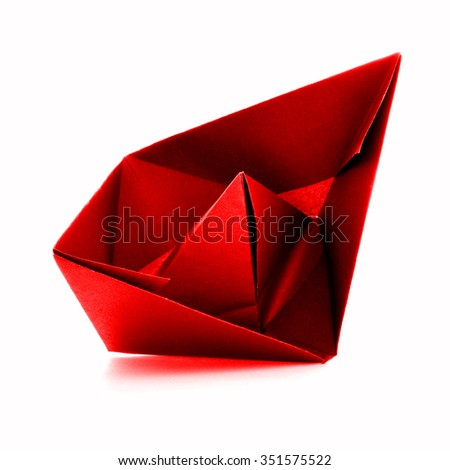 Red paper ship, origami sail boat, isolated on white background - stock photo