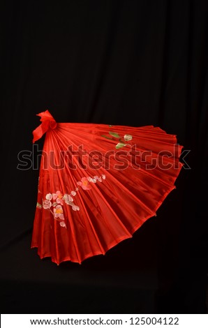 Red Parasol on Black Background/Red Asian Umbrella/Partially Opened Oriental Umbrella