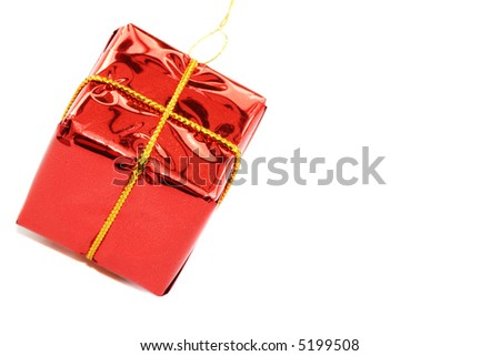 Red Parcel shaped Christmas tree decoration on a white background - stock photo
